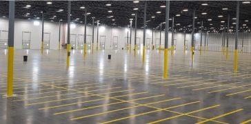 empty warehouse with yellow floor markings