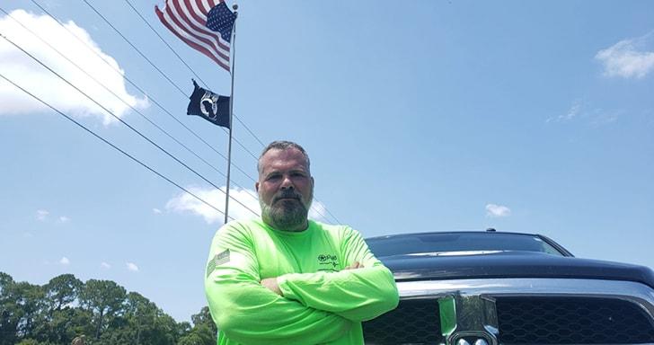 michael primato in front of gforce truck