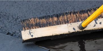 close-up of broom leveling concrete