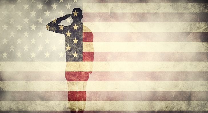 american flag with soldier saluting in background