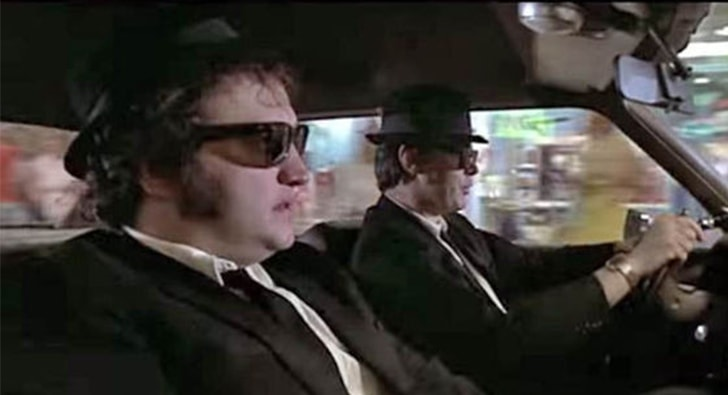 two gentleman from blues brothers driving in the car