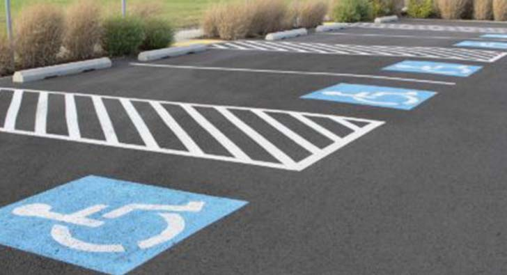 close-up of handicap parking lot spots