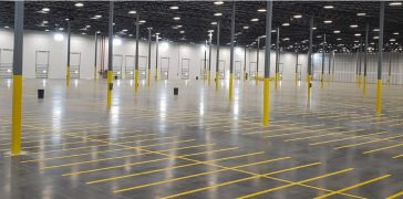 inside of a warehouse with fresh yellow floor markings