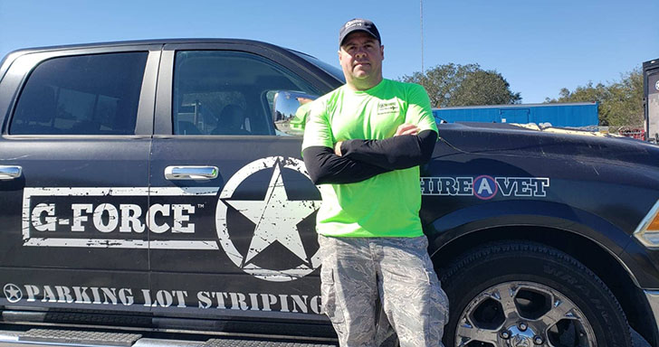 Eric Rine in front of g-force truck