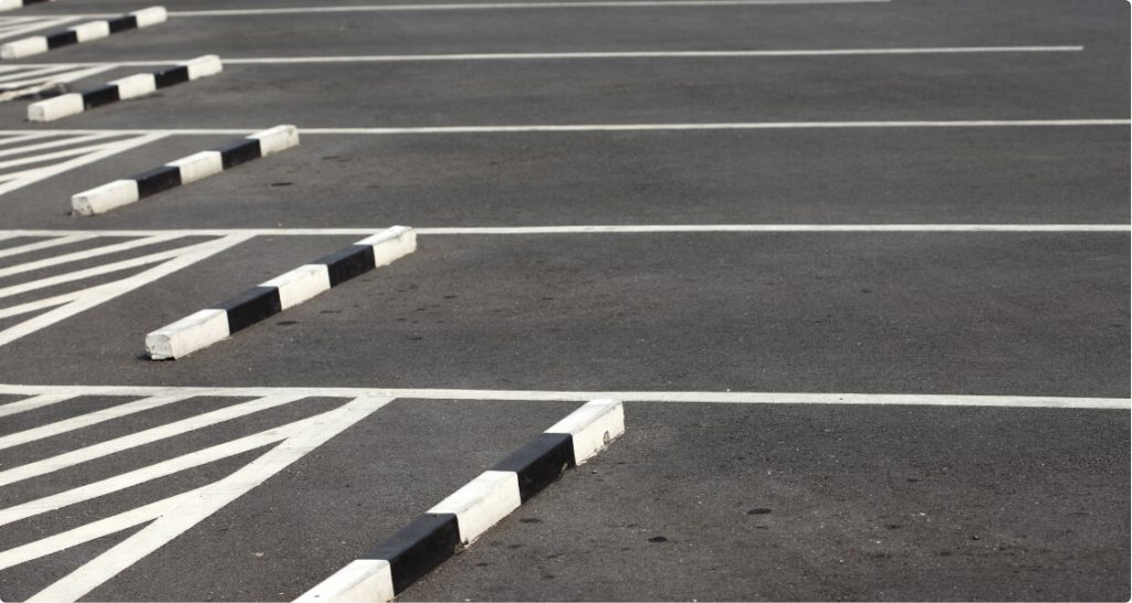 parking stops installed in a parking lot